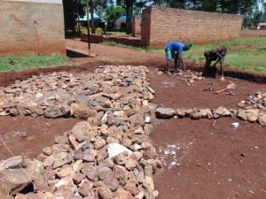 The Water Project:  Reinforcing Foundation With Stones
