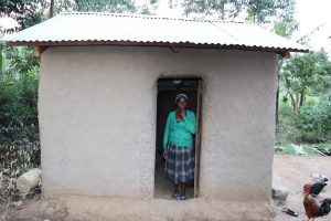 The Water Project:  Grace Stands In Doorway Of Her Kitchen