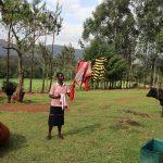 The Water Project: Harambee Community, Elijah Kwalanda Spring -  Nillah Takes Down Dry Clothes