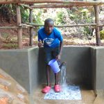 The Water Project: Chepnonochi Community, Shikati Spring -  Thumbs Up For Clean Water