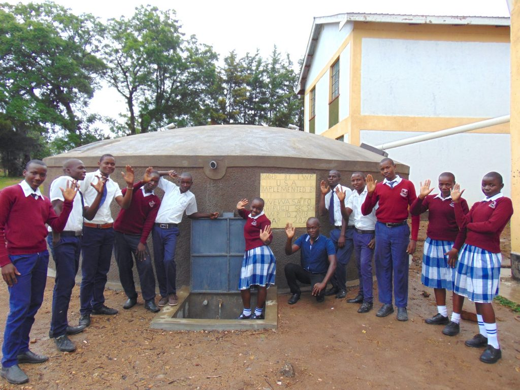 The Water Project : 41-kenya20113-students-and-field-officer-victor-celebrate-water-at-the-tank