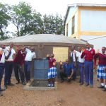 The Water Project: Friends Secondary School Shirugu -  Students And Field Officer Victor Celebrate Water At The Tank