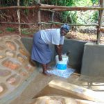 The Water Project: Chepnonochi Community, Shikati Spring -  Christine Gavalwa Fetches Water