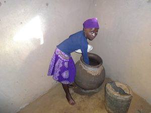 The Water Project:  A Child Fetches Water From The Pot