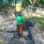 The Water Project: Bukhaywa Community, Ashikhanga Spring -  Bringing Clean Water Home