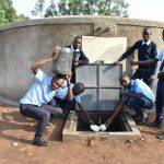 The Water Project: St. Peter's Khaunga Secondary School -  Boys Pose With Rain Tank