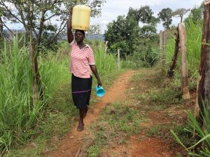 The Water Project:  Nillah Carrying Water