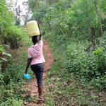 The Water Project: Harambee Community, Elijah Kwalanda Spring -  Nillah Carries Water Home