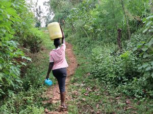 The Water Project:  Nillah Carries Water Home
