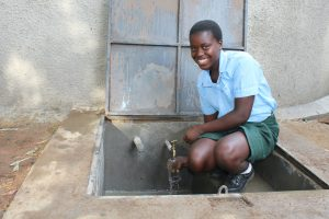 The Water Project:  Rinsing A Cup With Clean Water