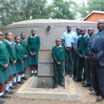The Water Project: Friends Kuvasali Secondary School -  Students And Principal Formally Pose At The Water Tank