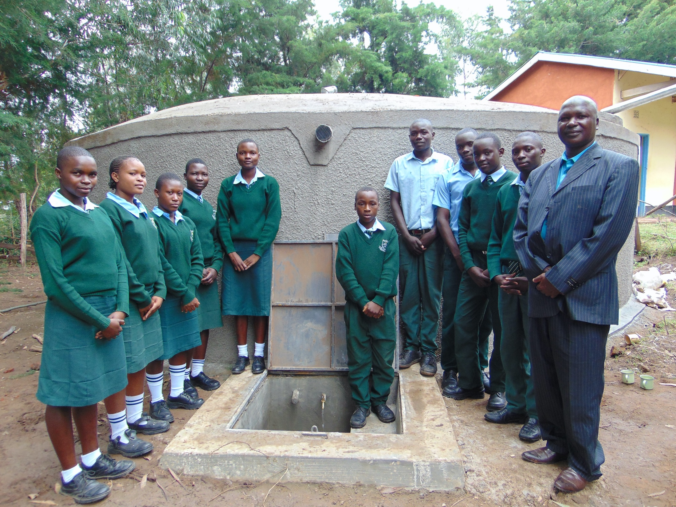 The Water Project : 47-kenya20112-students-and-principal-formally-pose-at-the-water-tank-2