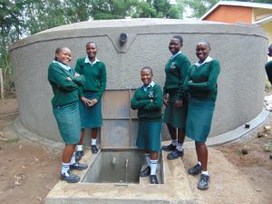 The Water Project:  Girls Pose At The Water Tank