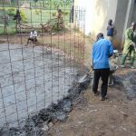 The Water Project: Friends Kuvasali Secondary School -  Setting Tank Wall Skeleton