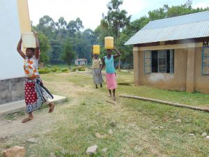 The Water Project:  Parents Carry Water To School For Construction