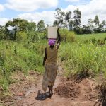 The Water Project: Mahira Community, Litinyi Spring -  Carrying Water Home