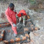 The Water Project: Bukhaywa Community, Ashikhanga Spring -  Pipe Setting