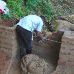 The Water Project: Chepnonochi Community, Shikati Spring -  Pipe Setting