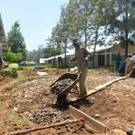 The Water Project: St. Peter's Khaunga Secondary School -  Pouring Concrete On Foundation