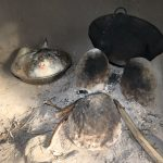The Water Project: Mukhonje Community, Mausi Spring -  Hen Sits On Eggs Next To The Stove