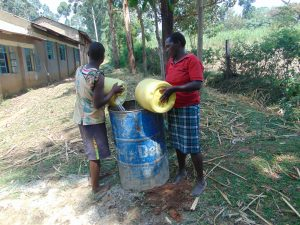 The Water Project:  Community Members Deliver Water For Construction