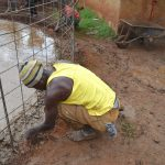 The Water Project: Gamalenga Primary School -  Fitting The Wire To The Foundation
