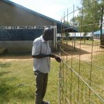 The Water Project: St. Peter's Khaunga Secondary School -  Preparing Wire Tank Walls