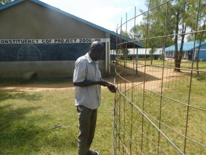 The Water Project:  Preparing Wire Tank Walls