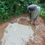 The Water Project: Chepnonochi Community, Shikati Spring -  Mixing Cement