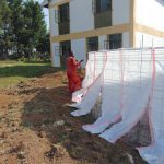 The Water Project: Friends Secondary School Shirugu -  Wrapping Wall In Sugar Sacks