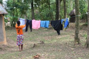 The Water Project:  Beatrice Hangs Clothes To Dry