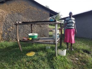 The Water Project:  A Woman Stands By Her Dishrack