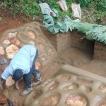 The Water Project: Chepnonochi Community, Shikati Spring -  Rub Wall Construction