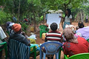 The Water Project:  Community Members Listen During The Training