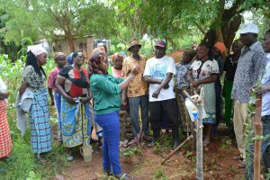 The Water Project:  Facilitator Leads Handwashing Demonstration