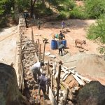The Water Project: Katovya Community -  Building Up Dam Walls