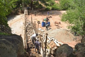 The Water Project:  Building Up Dam Walls