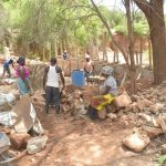 The Water Project: Katovya Community -  Community Members Working On The Dam