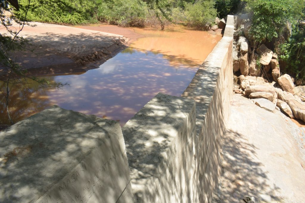 The Water Project : kenya19204-complete-dam-after-recent-rains