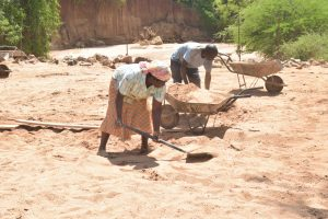 The Water Project:  Digging Sand To Mix With Cement