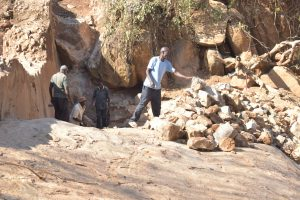 The Water Project:  Moving Rocks For Wall Construction