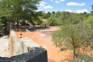 The Water Project:  Water Builds Up Behind Sand Dam