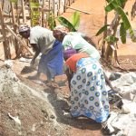 The Water Project: Kasekini Community -  Community Women Help Mix Cement