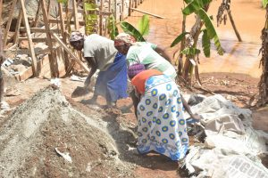 The Water Project:  Community Women Help Mix Cement