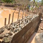 The Water Project: Kasekini Community -  Dam Wall Cement Dries