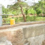 The Water Project: Kasekini Community A -  Well Fills Container
