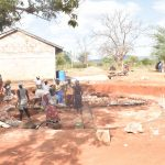 The Water Project: Murwana Primary School -  Community Members Help With The Foundation Work
