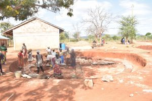 The Water Project:  Community Members Help With The Foundation Work