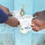 The Water Project: Nyanyaa Secondary School -  Filling Up Cups At The Tank