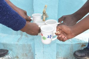 The Water Project:  Filling Up Cups At The Tank